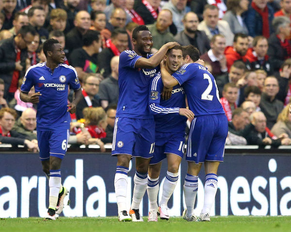 Chelsea's Eden Hazard (centre) celebrates scoring his side's first goal of the game with teammates during the Barclays Premier League match at Anfield, Liverpool