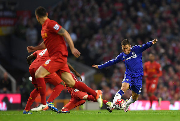 Liverpool's Kolo Toure and Chelsea's Eden Hazard battle for the ball