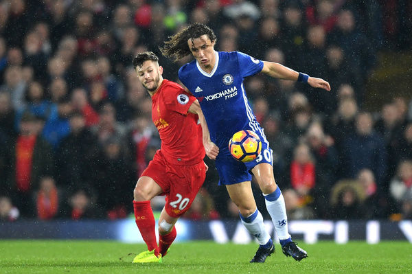 LIVERPOOL, ENGLAND - JANUARY 31: David Luiz of Chelsea and Adam Lallana of Liverpool compete for the ball during the Premier League match between Liverpool and Chelsea at Anfield on January 31, 2017 in Liverpool, England