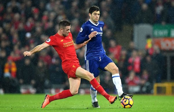 LIVERPOOL, ENGLAND - JANUARY 31: Jordan Henderson of Liverpool and Marcos Alonso of Chelsea compete for the ball during the Premier League match between Liverpool and Chelsea at Anfield on January 31, 2017 in Liverpool, England