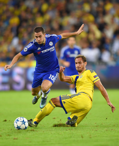 Maccabi Tel Aviv's Badias Carlos Garcia and Chelsea's Eden Hazard battle for the ball