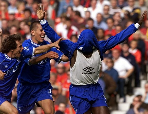 THIS PICTURE CAN ONLY BE USED WITHIN THE CONTEXT OF AN EDITORIAL FEATURE. NO WEBSITE/INTERNET USE UNLESS SITE IS REGISTERED WITH FOOTBALL ASSOCIATION PREMIER LEAGUE. Gian Franco Zola, left, and John Harley celebrate with Jimmy Floyd Hasselbaink