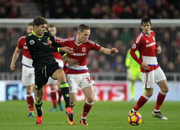 Middlesbrough's Adam Forshaw (right) and Chelsea's Marcos Alonso battle for the ball