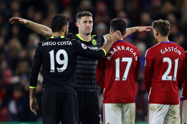 Chelsea's Diego Costa (left) and Chelsea's Gary Cahill appear to try and distract the Middlesbrough players in a wall