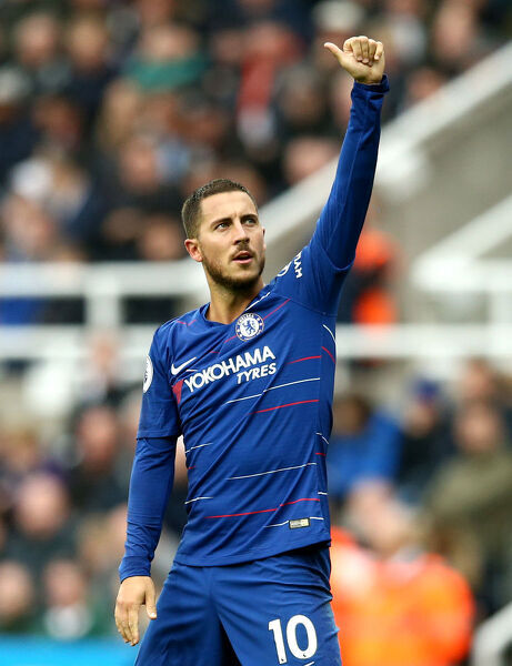 NEWCASTLE UPON TYNE, ENGLAND - AUGUST 26: Eden Hazard of Chelsea celebrates after scoring his team's first goal during the Premier League match between Newcastle United and Chelsea FC at St. James Park on August 26, 2018 in Newcastle upon Tyne, United Kingdom