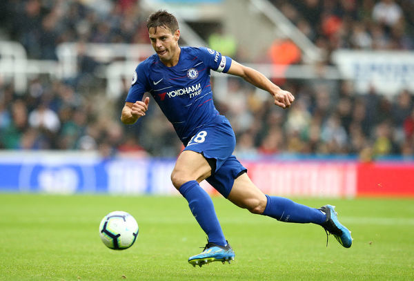 NEWCASTLE UPON TYNE, ENGLAND - AUGUST 26: Cesar Azpilicueta of Chelsea runs with the ball during the Premier League match between Newcastle United and Chelsea FC at St