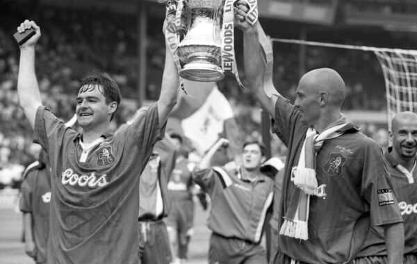 Chelsea's Steve Clarke and Frank Leboeuf celebrate with the FA Cup (Photo by Francis Glibbery/Chelsea FC/Press Association Image)