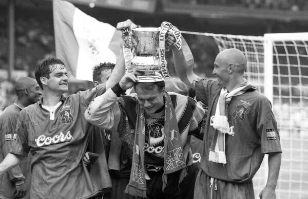 Chelsea's Steve Clarke, Frode Grodas and Frank Leboeuf after Chelsea win the FA Cup (Photo by Francis Glibbery/Chelsea FC/Press Association Image)