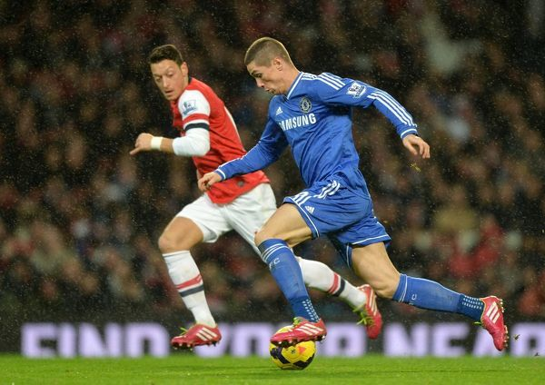 Chelsea's Fernando Torres (right) and Arsenal's Mesut Ozil battle for the ball