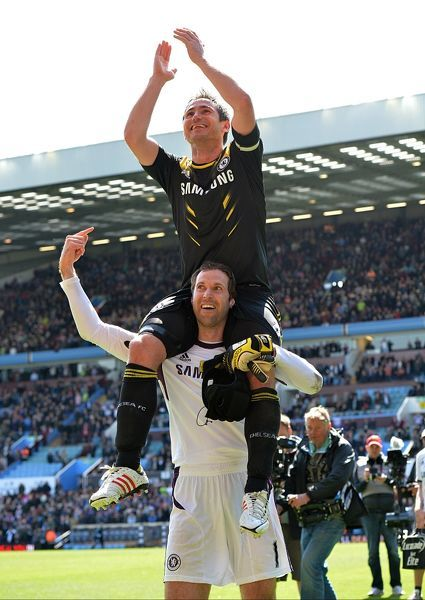 Chelsea's Petr Cech lifts Frank Lampard as he acknowledges the fans after the game