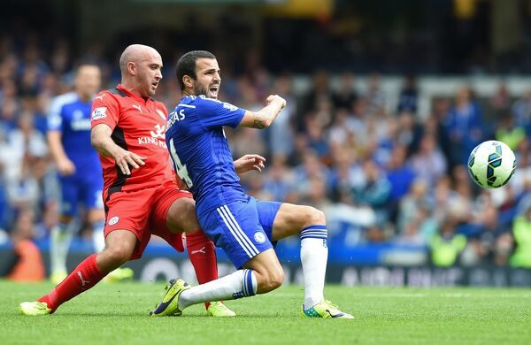 Chelsea's Cesc Fabregas (right) and Leicester City's Gary Taylor-Fletcher in action
