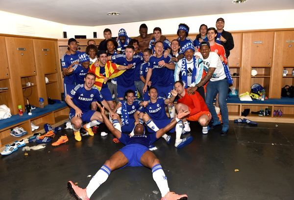 Chelsea players celebrate winning the title in the dressing room after the match