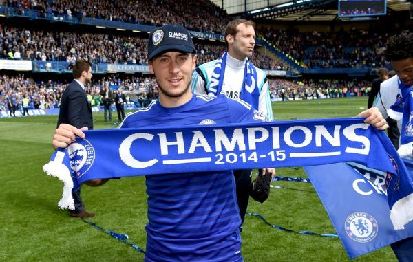 Chelsea's Eden Hazard celebrates winning the title on the pitch after the match