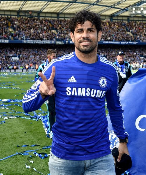 Chelsea's Diego Costa celebrates winning the title on the pitch after the match