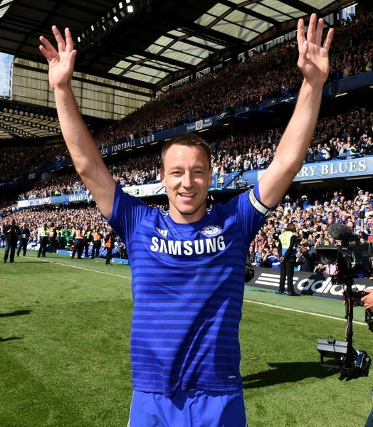 Chelsea's John Terry celebrates winning the title on the pitch after the match