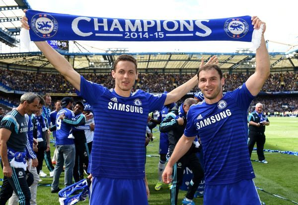 Chelsea's Nemanja Matic (left) and Branislav Ivanovic celebrate winning the title on the pitch after the match