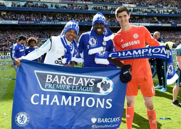 (left to right) Chelsea's Loic Remy, Kurt Zouma and Thibaut Courtois celebrate winning the title on the pitch after the match