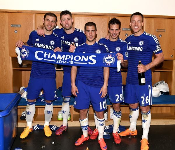 (left to right) Chelsea's Branislav Ivanovic, Gary Cahill, Eden Hazard, Cesar Azpilicueta and John Terry celebrate winning the title in the dressing room after the match