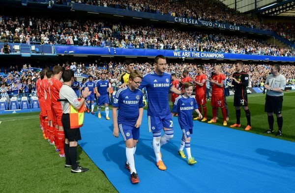 Chelsea's John Terry walks out through a guard of honour before kick-off