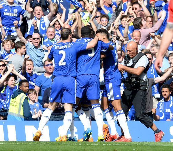 Chelsea's John Terry (obscured) celebrates scoring his side's first goal of the game
