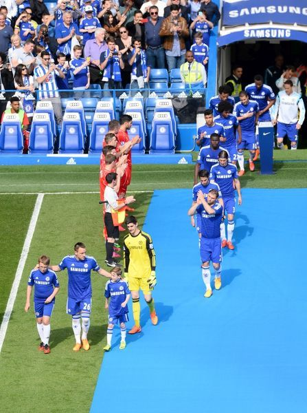 Chelsea players led by John Terry walk out for their guard of honour