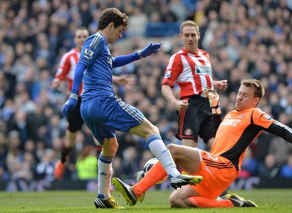 Sunderland's Matthew Kilgallon (back, right) scores an own goal following a deflection from a shot by Chelsea's Emboaba Oscar (left) deflects the ball into the back of the net