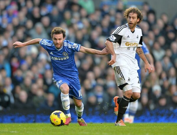 Chelsea's Juan Mata and Swansea City's Jose Canas (right) in action
