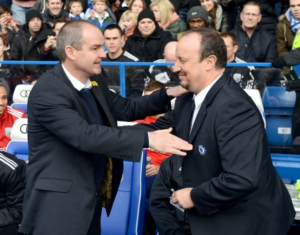 Chelsea interim manager Rafael Benitez (right) and West Bromwich Albion manager Steve Clarke (left) shake hands before kick-off