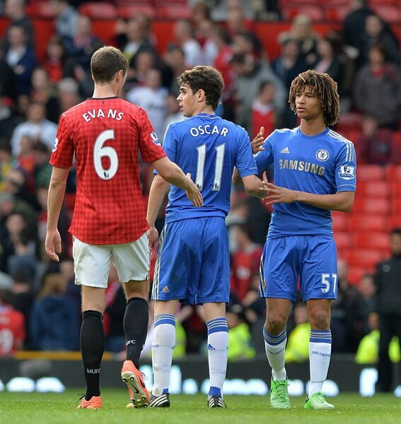 Chelsea's Oscar (centre) and Nathan Ake (right) alongside Manchester United's Jonny Evans (left) after the final whistle