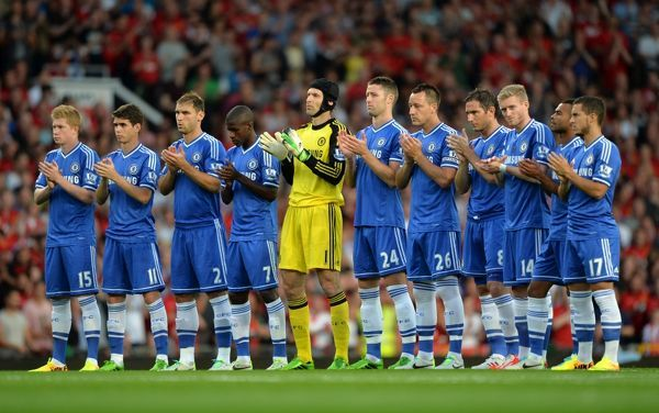 Chelsea players observe a minute's applause prior to kick-off in honour of former Manchester United footballers Brian Greenhoff, Ron Davies and Jack Crompton who all died since the last home match at Old Trafford