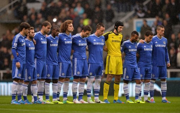 Chelsea players observe a minute's silence prior to kick-off