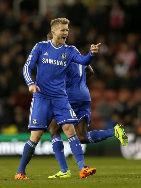 Chelsea's Andre Schurrle celebrates scoring his teams second goal of the game during a Barclays Premier League match between Stoke City and Chelsea at the Britannia Stadium on 7th December 2013 in Stoke On Trent, England