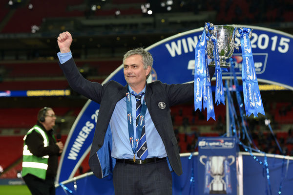 Chelsea manager Jose Mourinho celebrates with the trophy