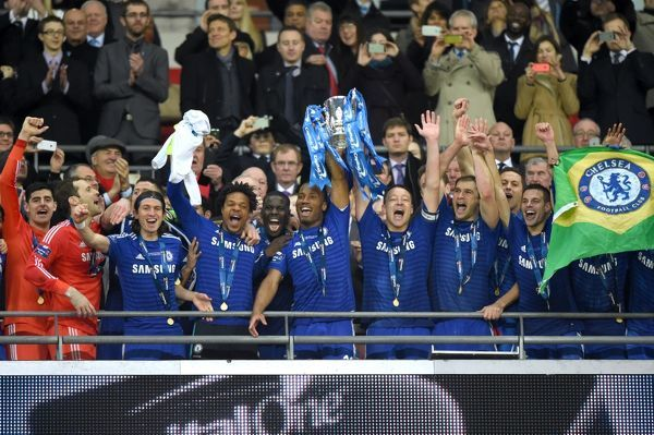 Chelsea's Didier Drogba and John Terry celebrate lifting the trophy with team-mates