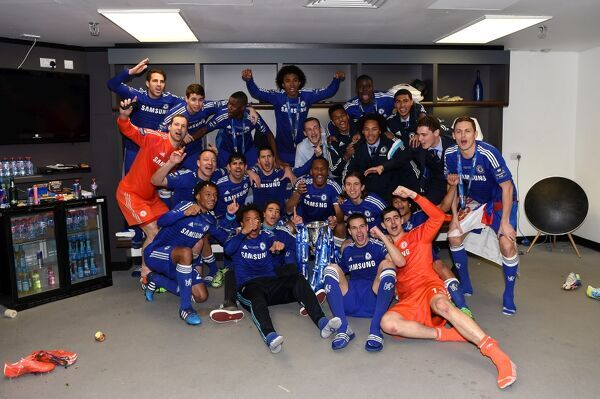 Chelsea players celebrate in the dressing room with the Capital One Cup