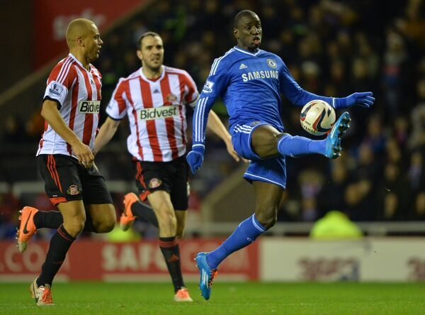 Sunderland's Wes Brown (Left) and Chelsea's Demba Ba (Right) battle for the ball