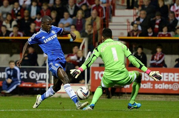Chelsea's Nascimento Ramires (left) scores his teams second goal of the game ahead of Swindon Town goalkeeper Wes Foderingham