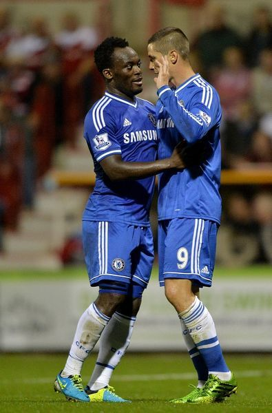 Chelsea's Fernando Torres (right) celebrates scoring his teams first goal of the game with teammate Michael Essien