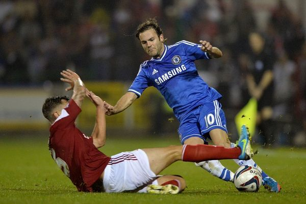 Chelsea's Juan Mata (right) and Swindon Town's Grant Hall battle for the ball