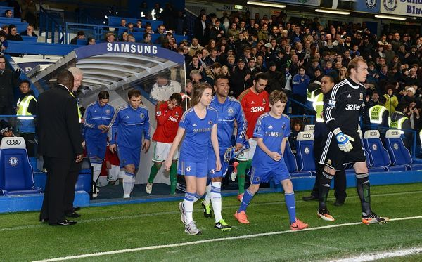 Chelsea and Swansea City players emerge from the tunnel for the match