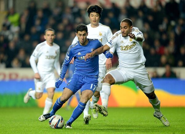 Chelsea's Eden Hazard (left) and Swansea City's Ashley Williams (right) battle for the ball