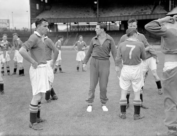 Chelsea manager Ted Drake (c) tries to even up the sides at half time