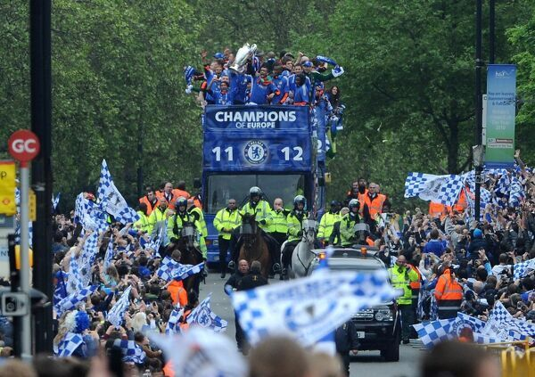 Chelsea players on the bus during the FA Cup and UEFA Champions League trophy parade in London