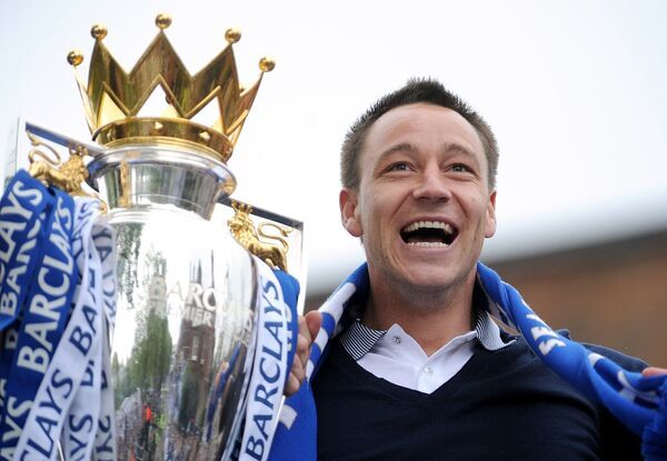 Chelsea's John Terry celebrates winning the Premier League and FA Cup double atop a double decker bus