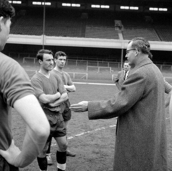England manager Walter Winterbottom talking to Chelsea striker Jimmy Greaves during a training session at Arsenal's Highbury stadium ahead of a match with Scotland
