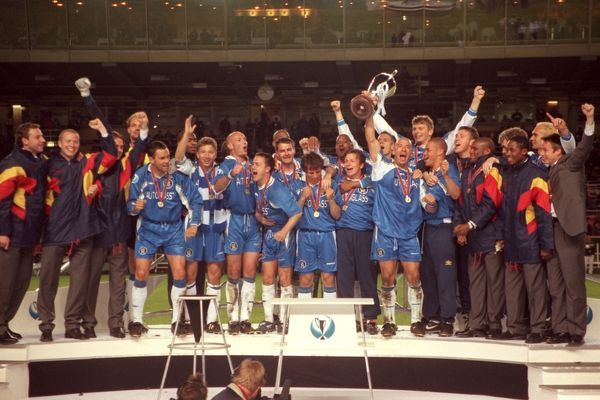 The Chelsea team celebrate with the trophy
