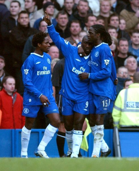 Chelsea's Jimmy Floyd Hasselbaink (c) is congratulated on scoring his first goal of the game by teammates Mario Melchiot (r) and Celestine Babayaro