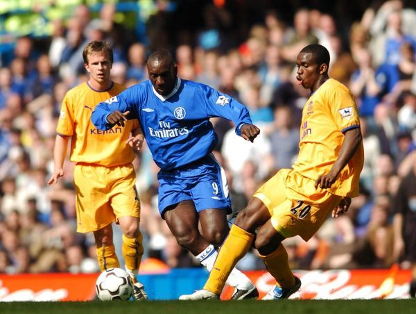 Chelsea's Jimmy Floyd Hasselbaink and Everton's Joseph Yobo