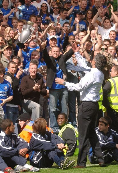 Chelsea manager Jose Mourinho throws a Premiership winners medal in to the crowd