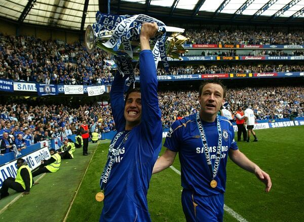 Chelsea's John Terry and Hernan Crespo celebrates with the Premiership Trophy